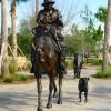 Bronze statues of a cowboy