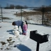 Grandma and Cate making snowman